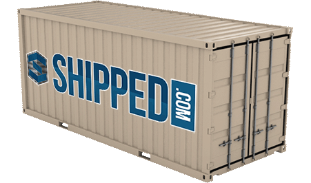 A new shipping container in beige with a large painted blue Shipped.com logo on the side