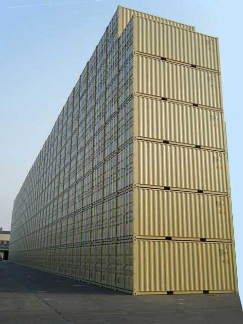 a giant stack of brand new 20ft conex shipping containers in beige color